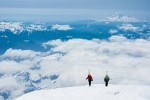 Pondella and Christy above the clouds on Rainier.
